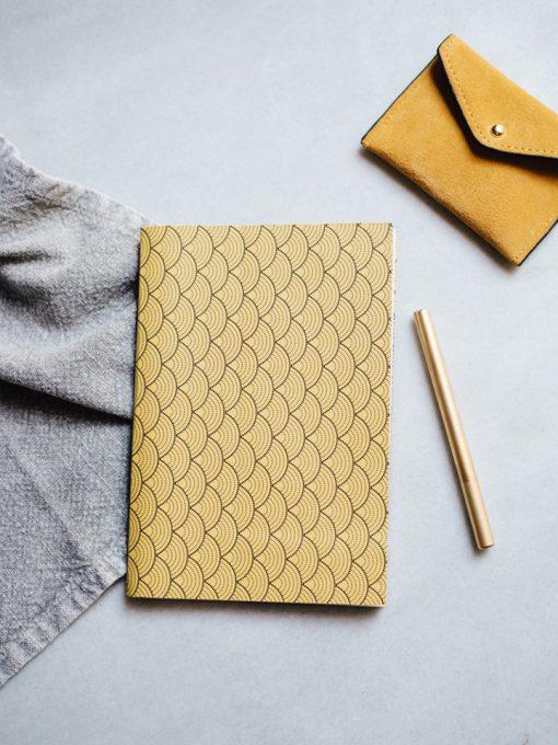 Cuaderno Deportivo amarillo 1